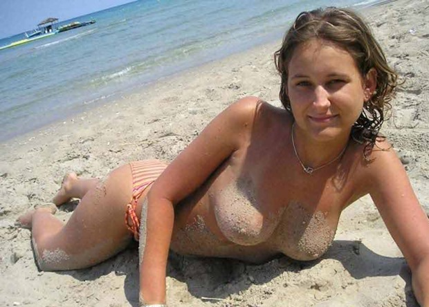 Topless Small tits cutie at the beach